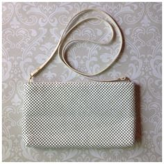 """WHITING & DAVIS WHITE MESH HANDBAG White enameled mesh bag.  Along strap that can be shoulder or cross body or remove to use as a clutch.  Dark grey signature print lining.  The bag is perfect.  The strap may be discolored ever so slightly...not at all noticeable when wearing.10.5"""" x 6"""". This bag is relatively new.  I have two WD vintage also Whiting & Davis Bags"""