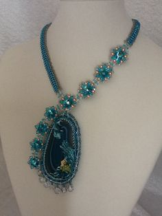Mermaid in the Ocean necklace by Modetti on Etsy, $250.00;  not a schema-idea of how to use agate slice