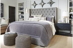 FINALLY PICKED A NEW BED! I love this because the grey is easier to clean and it is tall.The Sorinella Upholstered Bed from Ashley Furniture HomeStore (AFHS.com). $599 on sale. :)