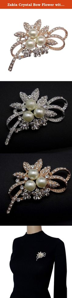 "Zakia Crystal Bow Flower with Faux Pearl Brooch Pin Bridal Brooches. It's a pretty flower bow brooch,a great gift for friends. This enchanting brooch adds a feminine touch of color to your look. Width: 6.5cm(2.56""), Length: 3.5cm(1.37"")."