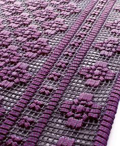 exterior rugs by Italian company Paola Lenti, embroidered by hand from aquatech & rope.