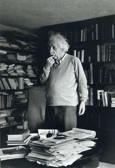 German born physicist who formulated the theories of relativity, Albert Einstein - ponders a problem in his paper-filled study in Princeton, New Jersey. A Nobel prize-winner for Physics in Original Publication: In black and white book Theory Of Relativity, E Mc2, Einstein Quotes, Albert Einstein Pictures, Albert Einstein Photo, Physicist, Lectures, Belle Photo, New Jersey