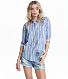 Light blue/narrow striped. Long-sleeved shirt in airy cotton fabric with a chest pocket and rounded hem.