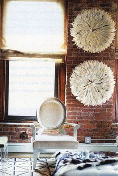 african hats made of white bird feathers make stunning bick wall decor