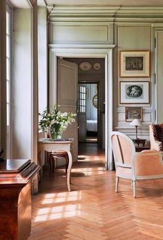 Lovely millwork, herringbone wood floors, and French antique furniture. Classic!