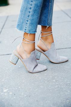Sparkler Wrap Mule | These must-have mules feature a statement glitter block heel and a party-ready rounded toe. Adjustable wrap detailing and a padded footbed for a comfy fit.