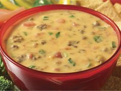 32 oz block Velveeta, 8 oz package cream cheese, 10 oz can Rotel, can cream of mushroom soup, 1lb ground beef or sausage, and 1 green onion.....Brown meat over medium heat & set aside. Cut up Velveeta & cream cheese into cubes & place in crock pot. Pour in Rotel & cream of mushroom & stir. Place on low for 1 hour. After 30 min add meat. Stir as needed.