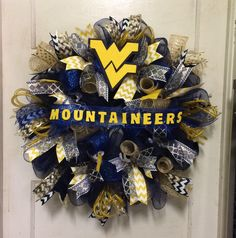 A personal favorite from my Etsy shop https://www.etsy.com/listing/530436797/wvu-mountaineer-wreath