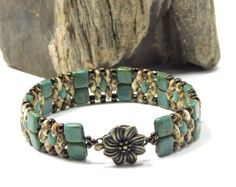 SUPERDUO CZECHMATE TILE Bracelet - White Picasso SuperDuos - Persian Turquoise Picasso Tiles - Brown Iris Toho Seed Beads - Flower Box Clasp by CinfulBeadCreations on Etsy