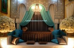Pelamin grey/turquoise/blue. Substitute the brown seating with a wooden seating. Keep the white flowers.