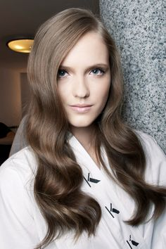To master these perfect waves, use a large curler and wrap larger sections of hair around it. Remember to comb your fingers through when you're done to ensure a natural wave.