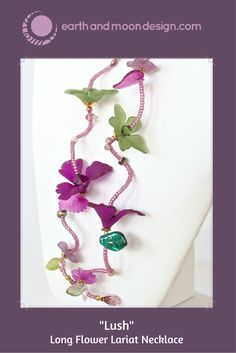 """Lush: Green and Purple Flower Lariat Necklace. This 50"""" lariat necklace of life-like Lucite flowers is the perfect piece for the woman with unique style. Color-rich and full of delightful details, you can wear this beautiful accessory many ways to complement your look. Wearable Art!"""