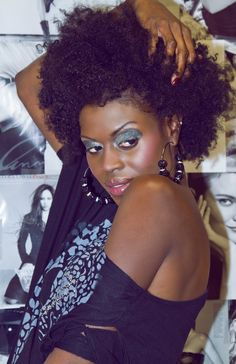Click the image for Reshonda's natural hair photos and regimen