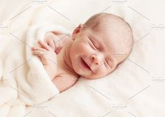Smiling newborn baby one week old by Lemuana on @creativemarket