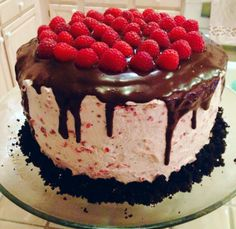 Dark chocolate raspberry buttercream cake with toasted marshmallow filling and chocolate ganache drizzle  No recipe, but I WANT IT.