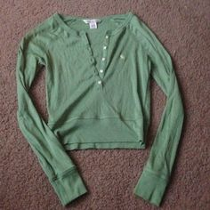 Green Abercrombie and Fitch cutoff pullover Clean, brand new! I never wore it. Thin sweater, cuts off around the belly button. Long sleeves. Small. Trade value $15. Location: Bin 1 Abercrombie & Fitch Sweaters