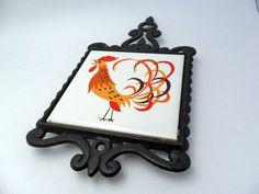 vintage rooster trivet 60s kitchen decor chicken kitchen decor iron trivet ceramic tile. $15.00, via Etsy.