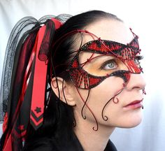 Red and black cyber goth masquerade mask, handmade. $350.00, via Etsy. beads and wire.