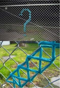 School ground Yarn Bombing...little league baseball field fences....lots of places to cross stitch fences