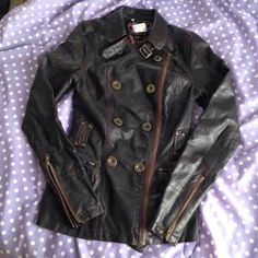 NWT leather jacket. Open to trades! New With Tags size XS Leather Jacket. Will also fit size small. Very comfortable. The pictures don't do it justice. It has tons of detail, functioning zippers on the sleeves, nice sized pockets, detail around the waist and on the back, also on the collar there is hardware. Super adorable jacket but sadly doesn't fit me :( I'm a medium after having two beautiful girls, but I bought it anyways. My loss is your gain and this beauty needs a good home!  Coming…