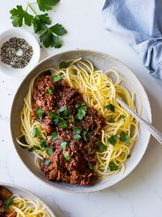 Red wine bolognese with mushrooms is healthy comfort food done right! Easy to make, this bolognese sauce is paleo-friendly served with zoodles, or enjoy it with your favourite (gluten free) pasta! #bolognese #redwinebolognese #healthydinner #paleo #glutenfree #dairyfree