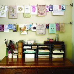 organize cards, invites and notes on a string with small clothespins