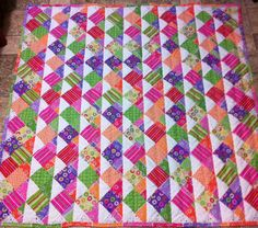 QUILT FOR SALE-#2 OF 2 PICS Made the back from the rest of the interlocking stars fabric. I think I like it better than the front. Used a walking foot and a wavy stitch down the center of each square. 56x56 Jenn-Alabama
