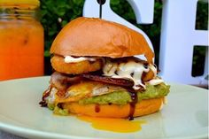 Whos ready to take on this bad boy? The American burger is packed with layers of crispy bacon egg smashed avo hash smoky bbq sauce and aioli served on a delicious brioche bun. The perfect fix for breakfast or lunch! by socialhideout Sydney Cafe, Sydney Food, Brioche Bun, American Burgers, Bacon Egg, Aioli, Milkshakes, Hamburger, Bbq