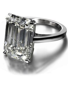 Not a big fan of the rectangle or square cut....but this Platinum engagement ring by De Beers would do.