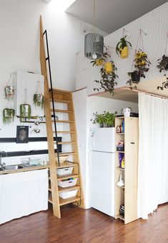 Kitchen leading to a loft in a modern artist studio