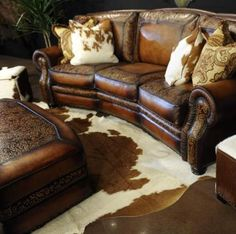 Hand-tooled leather sofa and ottoman