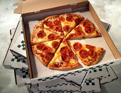 Illinois cops deliver pizza after arresting deliveryman....... Pepperoni pizza in cardboard take out box, stacked boxes. - Jeff Sarpa/StockFood/Getty Images