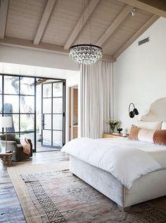 interesting rug idea, serene tones in vintage looking throw pillows, black detailing in windows and doors.