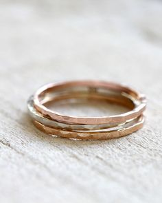 Solid 14k gold stacking rings. Hand hammered. https://www.etsy.com/listing/172290308/stacking-rings-14k-gold-stacking-rings