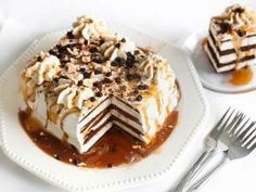 Caramel Torte : Stack nine ice cream sandwiches into three layers (so there are three sandwiches per layer) and cover with whipped topping. Use a piping bag to pipe decorative stars of whipped topping on top. Drizzle liberally with caramel sauce and sprinkle with chopped nuts and chocolate chips. The result is a deceptively fancy dessert that mimics the look of an icebox cake.