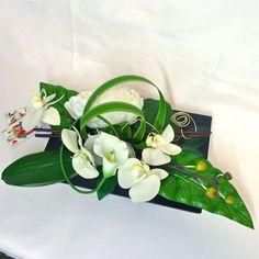 Arrangements fleurs artificielles on pinterest composition ikebana and vase - Centre de table fleurs artificielles ...