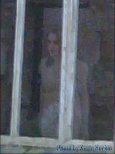 Gwrych Castle Ghost. The floor in the room in which the girl is standing collapsed many years ago so the figure is not that of a visitor to the castle. Some researchers believe the ghostly figure is that of the Winifred Cochrane, the Countess of Dundonald.
