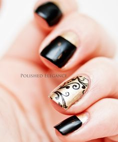 Black nails & one accent nail with gold & black scrolls & curlicues