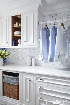 Crisp Whites Instead of taking up floor space with a standing drying rack, designer Dina Bandman installed a custom Lucite rod between two upper cabinets in this San Francisco laundry room for damp garments. See more laundry room ideas at HouseBeautiful.com.