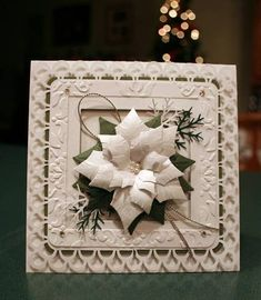 All though I was done with my Christmas cards this year when I saw all the absolutely gorgeous cards on here using this poinsettia die I just had to order it! I started out wanting to make an all white card but I just couldn't do it...my leaves needed to be green, then I might as well add just a little more green to the border. I really like how it came out. Merry Christmas Everyone!