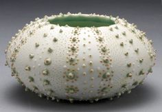 Sea urchin vessel. I really really need to try this decorating technique next…