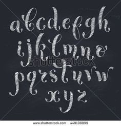 Handmade letters. Handwritten alphabet on blackboard. Hand drawn calligraphy. Modern chalk typography.