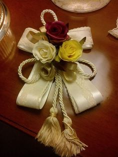 Tassel with roses and ribbons.