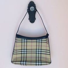 Authentic Burberry purse  Tiny scratch, not noticeable, a true classic!!! In great condition comes with dust bag. Authentic af  Burberry Bags Shoulder Bags