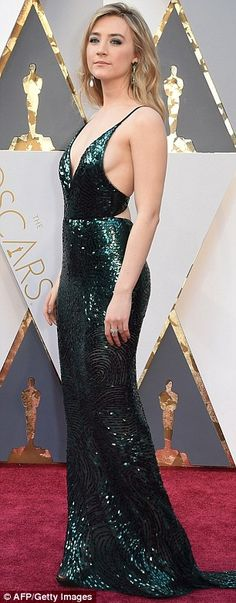 hem green with envy: The blonde looked great from all angles in her emerald gown...
