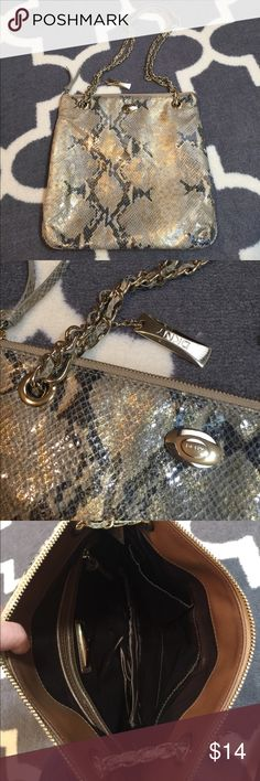 DKNY snake crossbody / shoulder purse This bag is a gold tone shiney snake print. The handle can be used doubled up or as a crossbody. Condition is a 9 out of 10 for very minor signs of wear. Lots of life to give on this pretty piece. Measures 11 x 11.5. Bundling is fun; check out my other items! No price talk in comments. No trades or holds. DKNY Bags