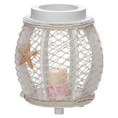 """Add a touch of nautical flair to your home decor with this charming piece, artfully crafted for lasting appeal.  Product: LanternConstruction Material: Wood and ropeColor: WhiteAccommodates: (1) Candle - not includedDimensions: 8"""" H x 7"""" Diameter"""