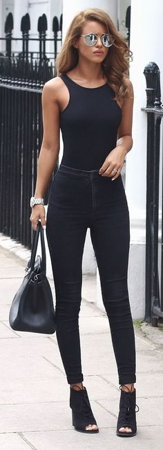 """And all-black outfit AND silver reflective sunglasses? This is for when a woman wants that """"it oughta be illegal to look this cool"""" look. #streetstyle"""