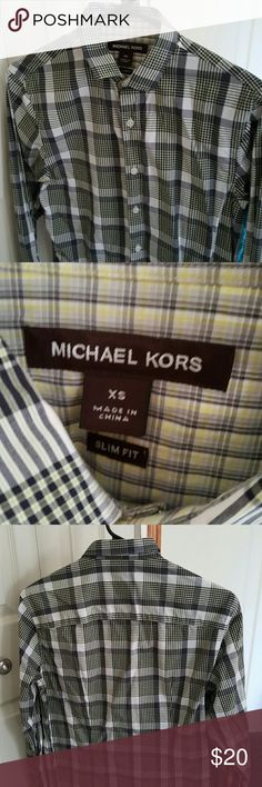Michael Kors long sleeve dress shirt Michael Kors long sleeve dress shirt. New. Never worn. Black/white/yellow plaid. Michael Kors Shirts Dress Shirts