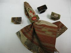 Napkin Rings from Left to Right #1473 Trap, Green Trap/Agate Cab, #104 Trap and Green Trap/Jasper Cab Novelty Napkin Floral Boules